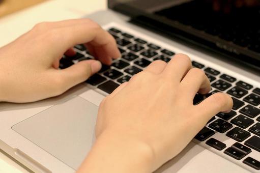 Hand hitting a laptop keyboard