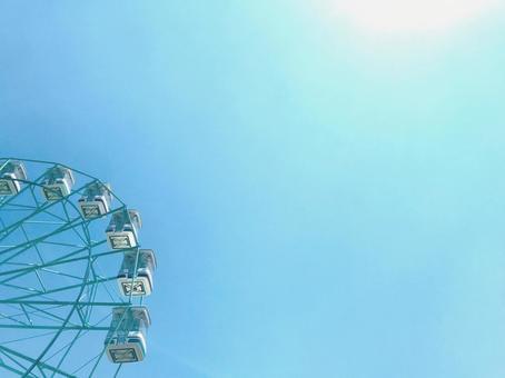 Cute square Ferris wheel and sunshine