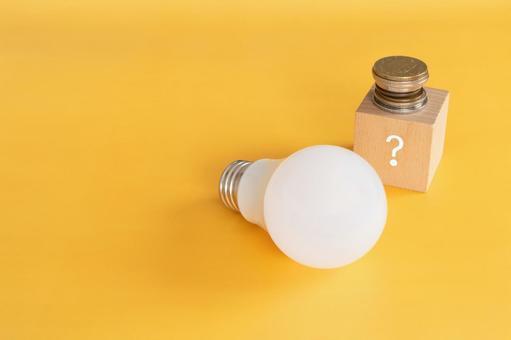 Electricity bill | Question mark building blocks, money and light bulbs