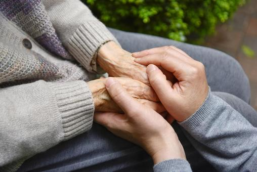 Holds the elderly caregiver