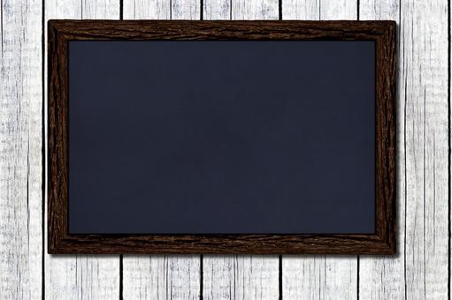 Blackboard hung on a white wood wall