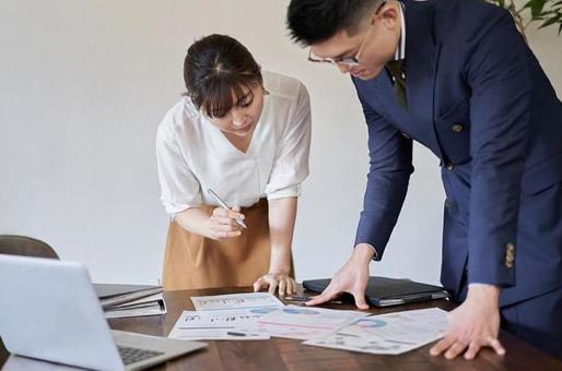 Asian business person having a meeting with paper materials