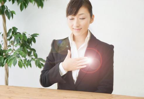 Business woman praying