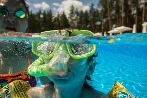 Boys dive in the pool with snorkelling 4.
