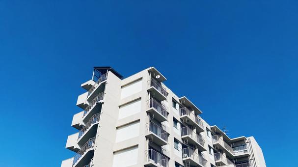 Condominium and blue sky real estate image