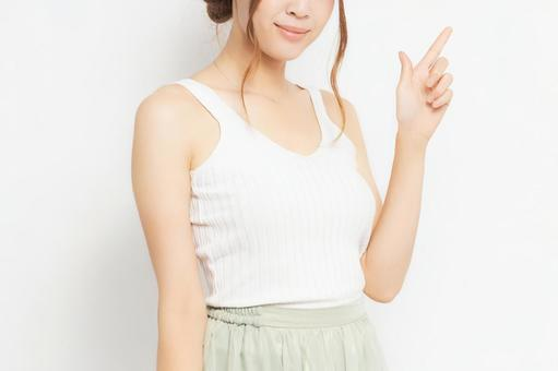 Young woman pointing to business point