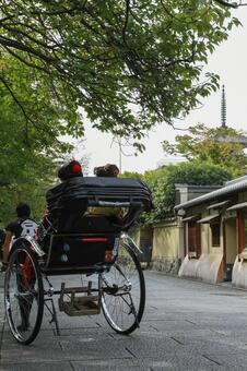 Maiko and rickshaw in Kyoto