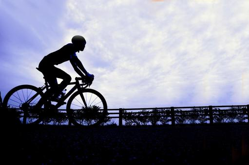 Cycling person and bicycle silhouette
