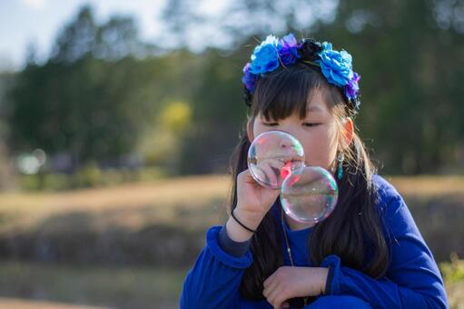 Children playing soap bubbles