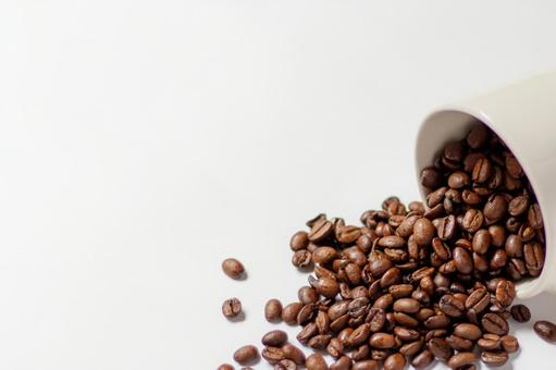 Coffee beans (spilling from the cup)