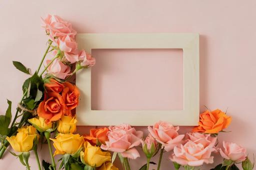 Pastel roses and photo frames