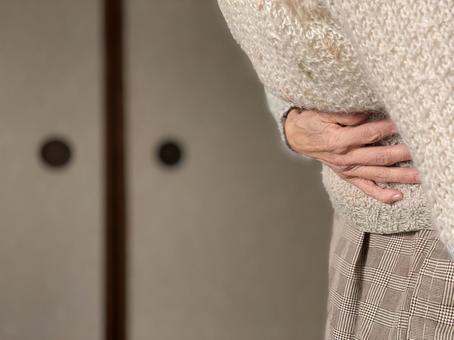 Elderly hands with stomachache