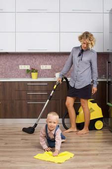 Working mother 6 placing a vacuum cleaner with my son who imitates cleaning