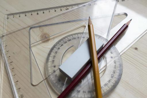 Pencil and protractor and triangular ruler