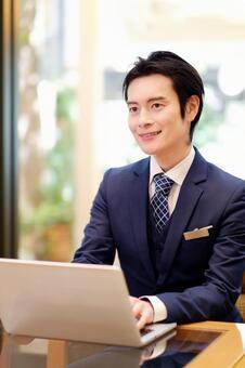 Hotel man using a laptop 4
