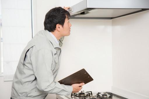 A man checking the ventilation fan