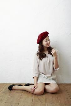 Woman sitting on a hat 1