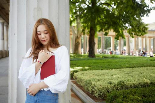 Asian woman holding a book 2