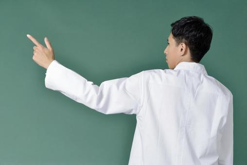 Male wearing a white coat that faces backwards 5