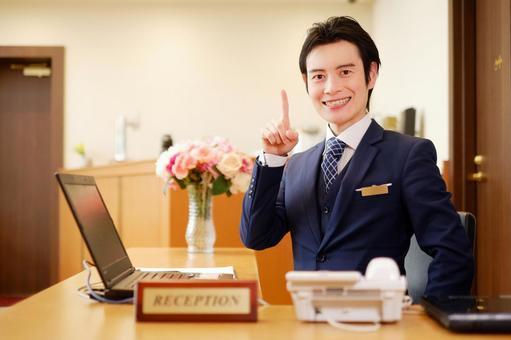 Hotel man who raises his index finger 7
