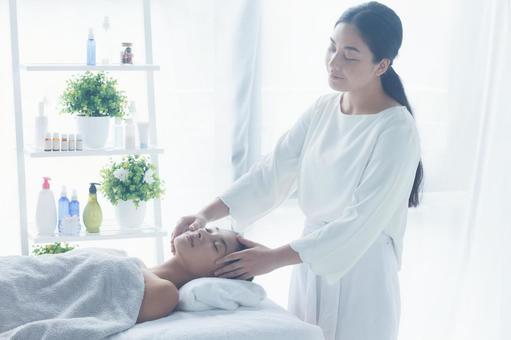 Woman receiving facial esthetic 11