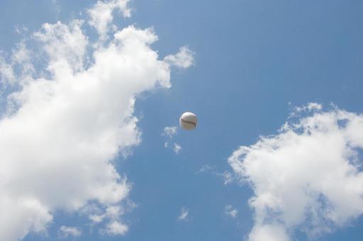 Baseball ball in the blue sky