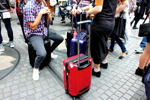 Tourists and suitcases