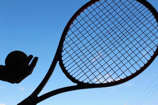 Tennis racket and blue sky
