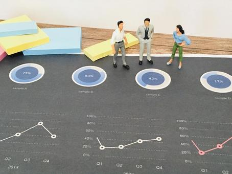 Business scene (three people discussing by looking at the graph)