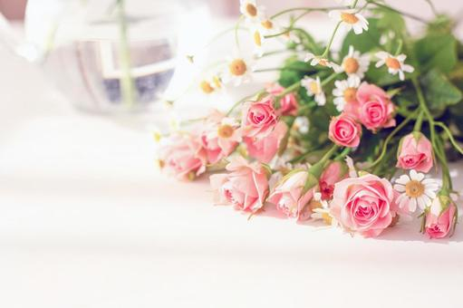 Image of spring morning Pink rose bouquet and glass vase
