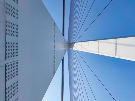 The main tower of the Tatara Bridge looking up from the sidewalk