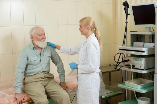 Foreign nurse female doctor examining with a foreign elderly man who undergoes a gastroscope camera examination 11