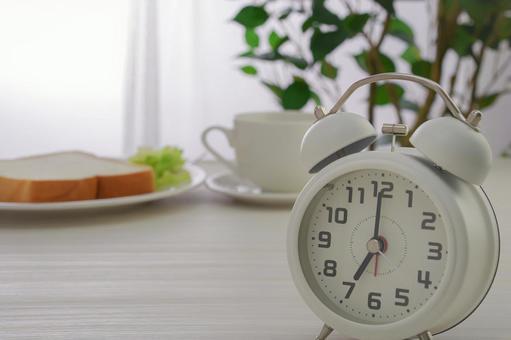 Alarm clock and breakfast