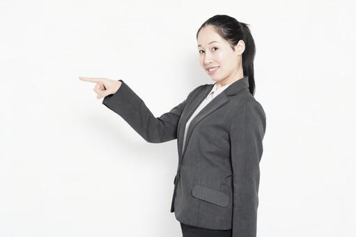 Woman pointing at business point