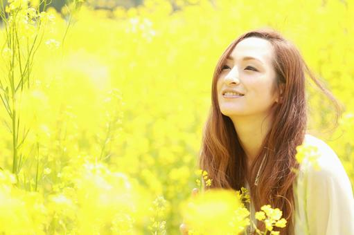 Rape blossoms and woman