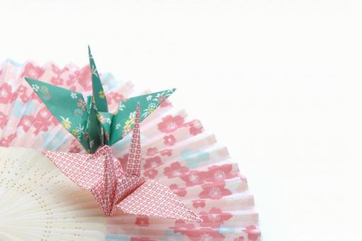 Origami crane on the folding fan