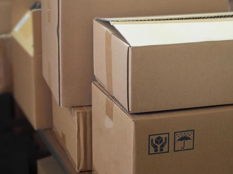 Cardboard boxes lined up in the warehouse