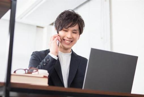 Image of a businessman operating a personal computer