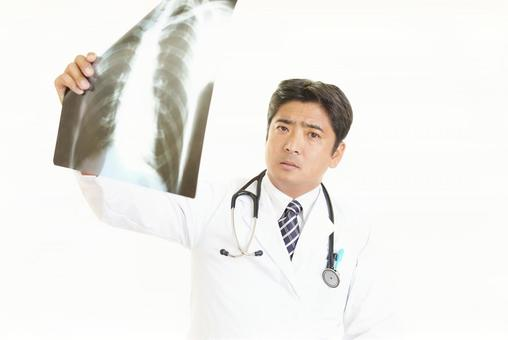 A serious facial expression doctor with a roentgen photo