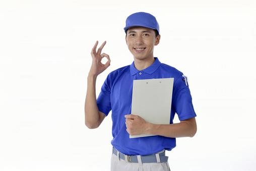 Male who has material and makes an okay sign 1