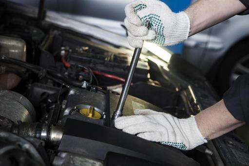 Automobile mechanic who opens the hood and uses a wrench 3