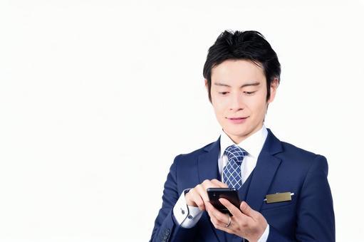 Hotel Man 2 using a smartphone