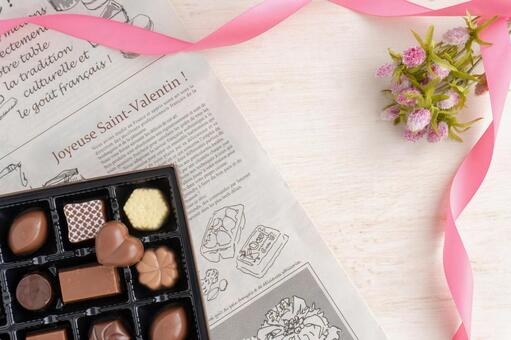 Valentine's chocolate, flowers and ribbon