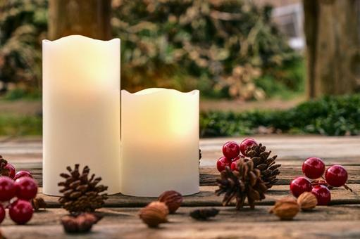 Autumn candles and nuts