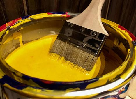 Bucket with yellow paint