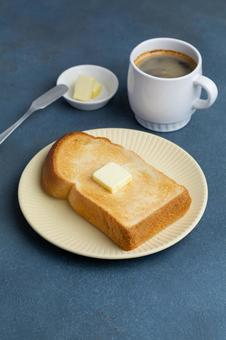 Buttered bread and coffee