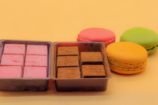 Raw chocolate and macaroons lined up in a container