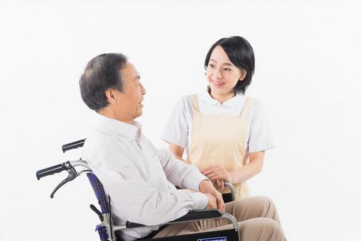 A nurse and a wheelchair male 4