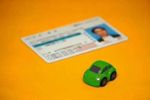 Driver's license green minicar yellow background