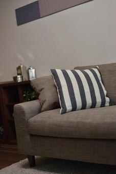 Modern beige sofa and striped cushions